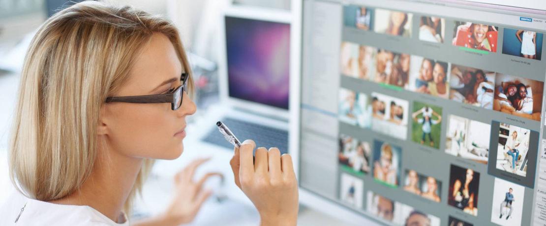 Woman looks at a media screen