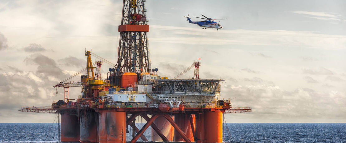 Oil rig and helicopter