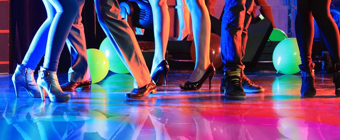 colourful dancefloor with peoples feet on it